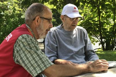 Volunteer with resident of the Veterans Memorial Building